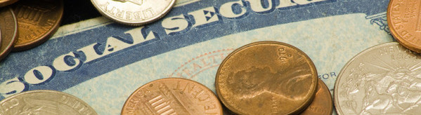 Picture of social security card surrounded by old pennies nickels dimes quarters